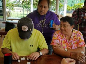 Roberta teaching our clients how to play Yahtzee