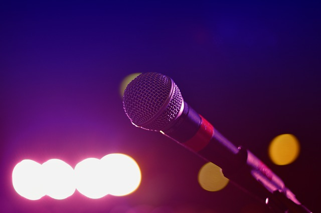 Microphone in a dark room with brightlights
