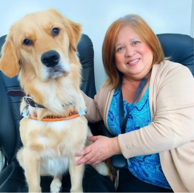 Executive Director Jeanne Torres and her guide dog Maggie
